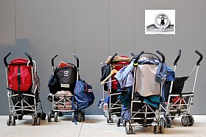 Buggies parked at an art gallery