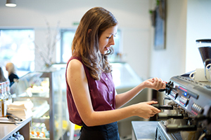 Woman serving in coffee shop