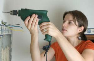 brunette woman drilling wall