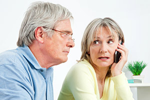 Couple receiving a nuisance call