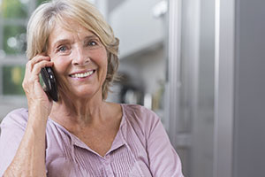 elderly woman using cordless phone