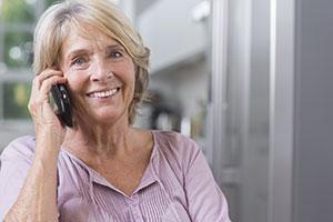 elderly woman using cordless phone