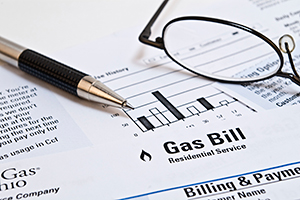 Energy bill and coins