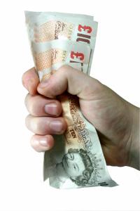 hand fist grabbing £10 notes