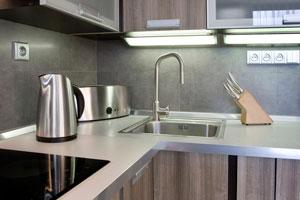 A modern kitchen worktop with sink