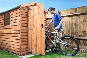 Putting bike in shed