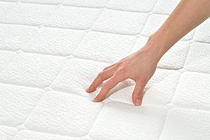 hand on mattress