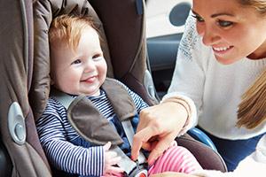 Parent fitting child car seat
