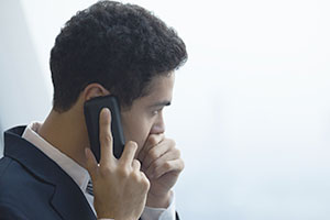 Man receiving a nuisance call