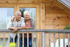Older couple outside house