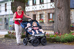 parent with double pushchair