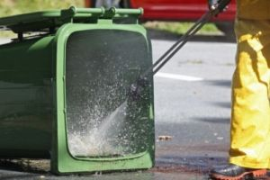 Pressure washing a wheelie bin