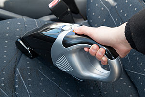 Handheld vacuum cleaner in car