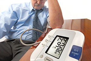 Man-measuring-blood-pressure-and-showing-high-blood-pressure