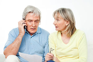 retired couple on mobile phone