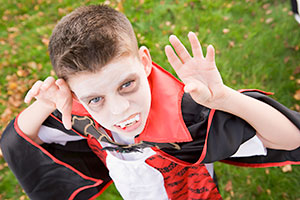 child dressed as a vampire