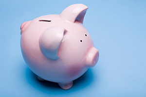 Pink piggy bank on a blue background