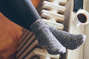 Feet resting on heater