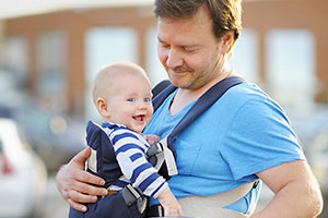 Front baby carrier with baby and dad