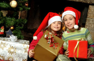 Two children with Christmas presents