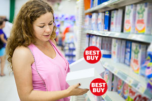 Woman holding two mystery products with Best Buy logos on
