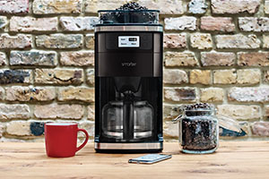 Filter coffee machine with cup and coffee beans