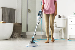 Woman using a steam mop in her home