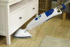 Cleaning under furniture with the Abode steam mop