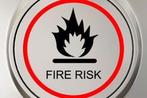 Image of a warning sign with the words 'fire risk' inside it.