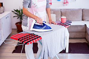 Image of a person ironing
