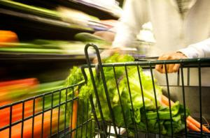 Supermarket shopping trolley with vegetables in it