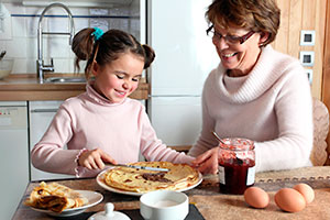 Woman and child eating pancakes together