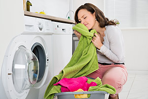 Woman smelling freshly-washed towels