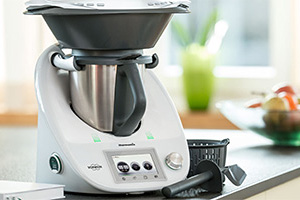 Image of the Thermomix TM5 food processor on a kitchen worktop
