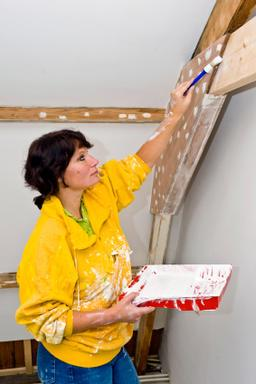 Woman carrying out DIY work