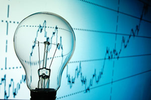 Light bulb with energy bills graph