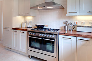Image of steel range cooker in kitchen