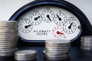 Energy meter with piles of money