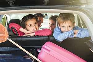 children on holiday in a car