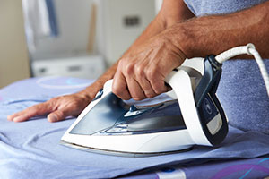 Image of a man ironing