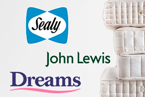 Mattresses from leading brands stacked in a pile
