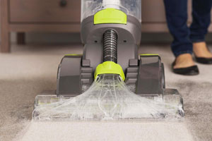 Carpet cleaner being used