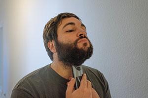 Man using beard trimmer