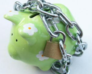 Piggy bank with a chain and padlock around it