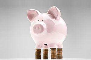 Piggy bank on coin stilts