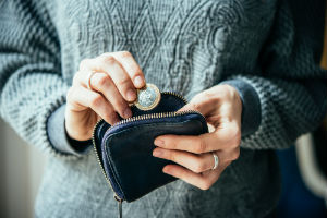 Woman pulling coins from a purse