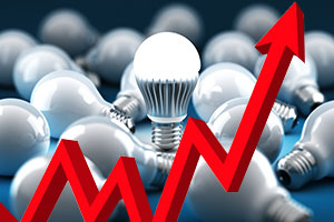 graph showing upward trend in front of lightbulbs