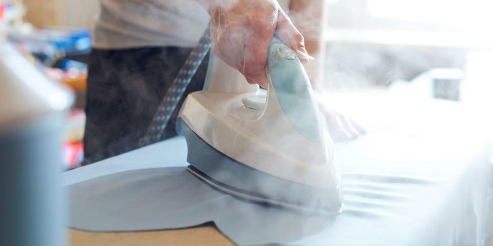 Blue and white steam generator iron ironing towel