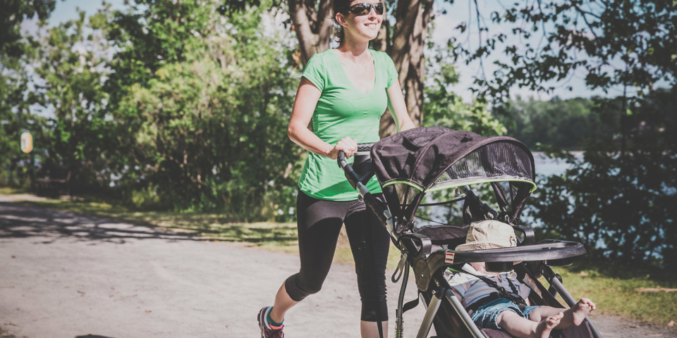 Which? Best Buy pushchairs Mother Running Walking With baby Stroller in Park