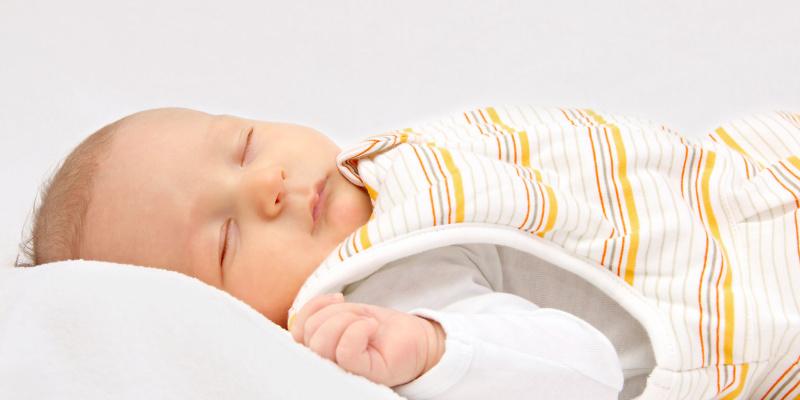 Baby sleeping in baby sleeping bag